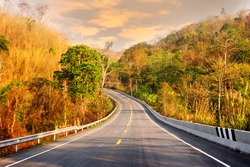 Scenic highway, difficult terrain, limited visibility on the road in mountains in North of Thailand, January. Highway in mountain semi-deciduous forest in Southeast Asia