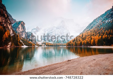 Scenic image of alpine lake Braies (Pragser Wildsee). Location place Dolomiti national park Fanes-Sennes-Braies, Italy, Europe. Great picture of wild. Explore the beauty of earth. Tourism concept.  #748728322