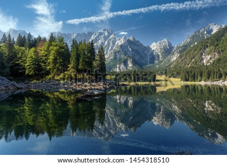 Scenic image of fairy-tale Mountain lake under sunlit. Amazing Nature Landscape. Wonderful sunny morning. Beautiful scenery of the majestic Fusine lakeside in Julian Alps. Perfect natural background #1454318510