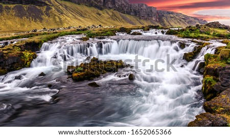 Scenic image of Iceland nature. Amazing Natural scenery. Colorful summer sunrise, Waterfall with dramatic picturesque sky. Picture of wild area. Iceland the most beautiful and best travel place Сток-фото ©