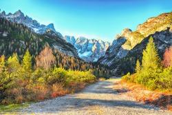 Scenic image of rocks and road in National Park Tre Cime di Lavaredo.  Location: National Park Tre Cime di Lavaredo,  Dolomiti alps, South Tyrol, Italy, Europe.