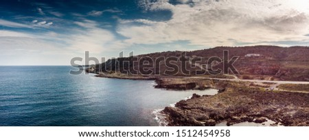 Scenic island and mountain landscape against cloudy sky, Crete, Greece