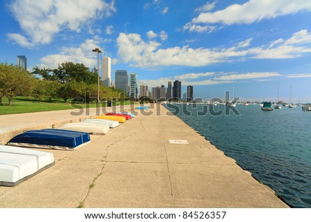 Scenic Lakeshore Trail along Lake Michigan and Grant Park in downtown Chicago with boats docked along the shore.
