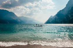 Scenic landscape of beautiful Garda lake and mountains, Italy. Nature background
