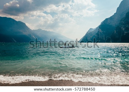 Scenic landscape of beautiful Garda lake and mountains, Italy. Nature background #572788450