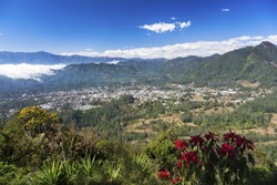 Scenic Landscape View of Guatemala Highlands, Sierra Madre Mountains and Local Village from Summit of Indian Nose Volcano above Lake Atitlan