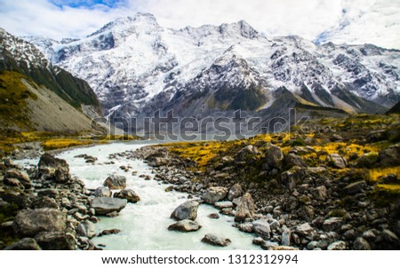 Scenic landscape view of Hooker Valley, Aoraki/Mount Cook National Park, South Island of New Zealand. Snow covered mountains. Tourist (backpackers) popular hiking or walking attraction/destination. #1312312994