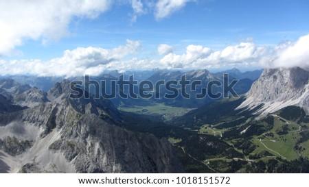Scenic landscape while trekking in the austrian alps (Wettersteingebirge) #1018151572