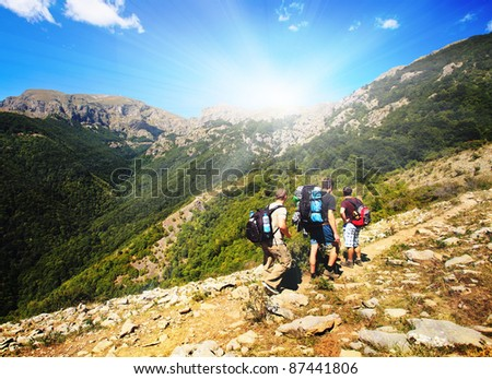 scenic landscape with group adventure in hiking