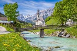 Scenic mountain landscape in the Bavarian Alps with famous Parish Church of St. Sebastian in the village of Ramsau, Nationalpark Berchtesgadener Land, Upper Bavaria, Germany