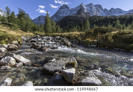 Scenic mountain stream in the italian alps