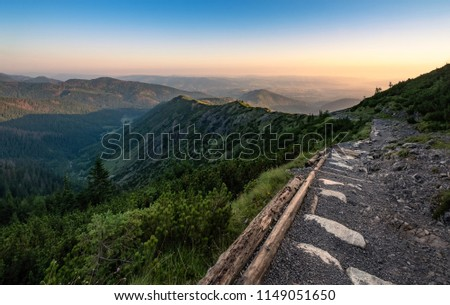 Scenic mountain view with mood sunrise and path at summer morning in Tatra National park, Poland #1149051650