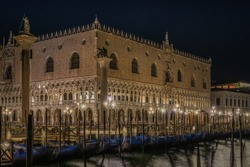 Scenic Night view of Doge's Palace (Palazzo Ducale) and illuminated St. Mark's square, Venice, Italy