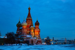 Scenic night view of famous nine domed Saint Basils Cathedral or Pokrovsky Cathedral on Red Square in Moscow. Popular cultural symbols of Russia..