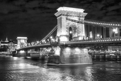 Scenic night view of the famous Szechenyi lanchid - Chain Bridge - in Budapest, Hungary. Black and white photo