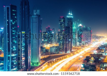 Scenic nighttime skyline of downtown Dubai, United Arab Emirates. Aerial view on highways and skyscrapers in the distance. #1159362718