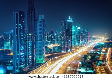 Scenic nighttime skyline of Dubai, United Arab Emirates. Aerial view on highways and skyscrapers in the distance.  #1187022295