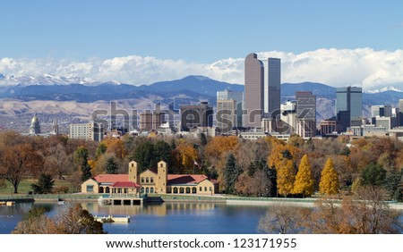 Scenic of Denver Colorado skyline, with Rocky Mountains in the background and City Park Lake in the foreground.