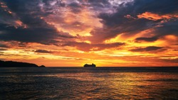 scenic of dramatic sunset skyline with seascape and travel cruise ship