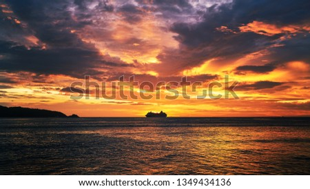 scenic of dramatic sunset skyline with seascape and travel cruise ship #1349434136