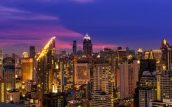 scenic of night urban cityscape skyline and golden building with twilight time