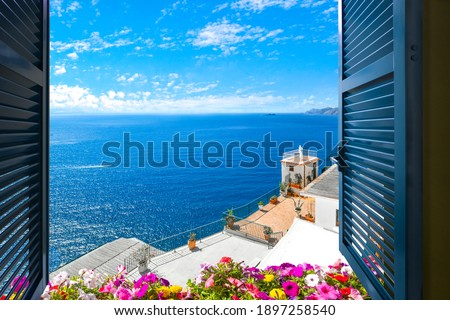 Scenic open window view of the Mediterranean Sea from a room along the Amalfi Coast near Sorrento, Italy