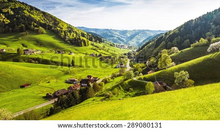 Scenic panorama view of a picturesque mountain village in Germany, Muenstertal, Black Forest. High-resolution summer vacation and ecology background.