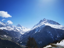 Scenic panorama with La Dent Blanche peak in Swiss Alps on a sunny spring day