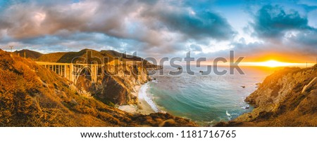 Scenic panoramic view of California Central Coast with historic Bixby Creek Bridge along world famous Highway 1 in beautiful golden evening light at sunset, Monterey County, California, USA