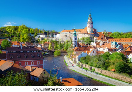 Scenic panoramic view of historic city center of Cesky Krumlov with famous Cesky Krumlov Castle and idyllic Vltava river on a beautiful sunny day with blue sky in spring, South Bohemia, Czech Republic Stock photo ©