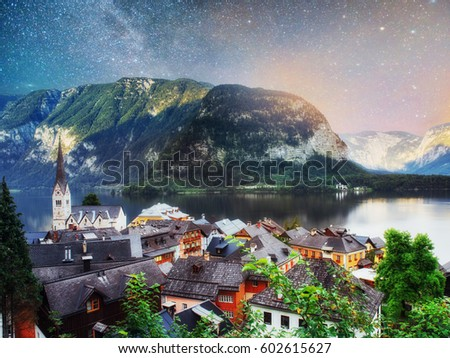 Scenic panoramic view of the famous mountain village in the Austrian Alps. Fantastic milky way. Starry sky. Hallstatt. Austria