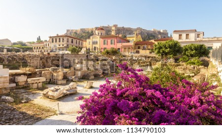 Scenic panoramic view of the Library of Hadrian, Athens, Greece. It is one of the main landmarks of Athens. Beautiful scenery of Athens with ancient Greek ruins. Famous Acropolis in the background.