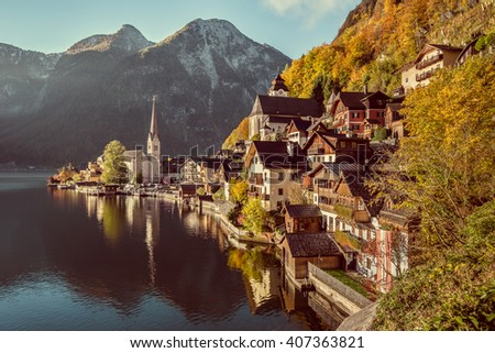 Scenic picture-postcard view of famous Hallstatt mountain village with Hallstatter See in the Alps in beautiful golden morning light in fall with retro vintage filter, region of Salzkammergut, Austria