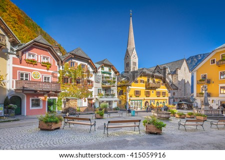 Scenic picture-postcard view of the historic town square of Hallstatt with traditional colorful houses and church at Hallstatter See in the Austrian Alps in fall, region of Salzkammergut, Austria Stock fotó ©