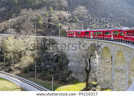 Scenic Railroad Pictures of Alps Train on viaduct