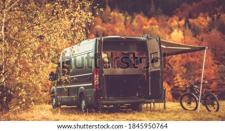 Scenic Recreational Vehicle RV Camping Spot with Fall Foliage Scenery. Class B Motorhome Boondocking in the Remote Place. Outdoor and Recreation Theme.