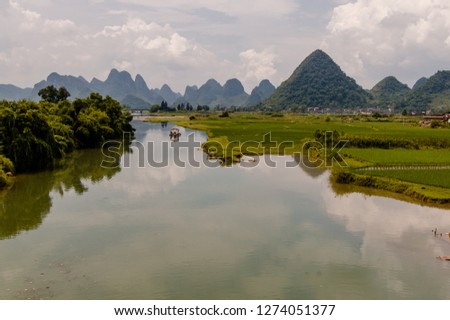 scenic river in china with conical mountains