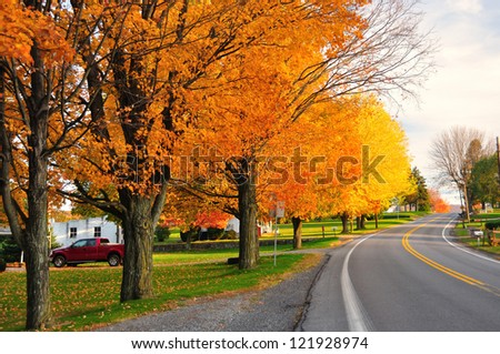 Scenic Road during fall in rural Pennsylvania - stock photo