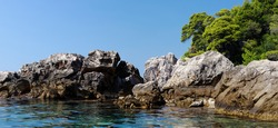Scenic rocks and sea near Dubrovnik, Croatia on bright summer day