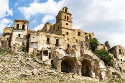 Scenic ruins of abandoned buildings in Craco, an abandoned ghost town in Basilicata region, Italy