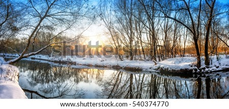Scenic russian winter wonderland sunset view of non frozen river with trees scenery reflections on water panoramic wide nature background scene