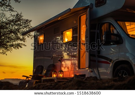 Scenic RV Camping Spot During Sunset. Class C Motorhome Camper Van. Travel Industry Theme.