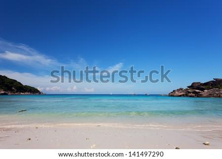 Scenic sand beach under bright blue sky, Similan Islands, Thailand