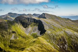 Scenic Scottish landscape. Mamores hills in Scottish Highlands on a cloudy summer day.
