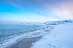 Scenic seascape of Barents Sea coastline in village Teriberka. Morning arctic winter landscape in Murmansk region of Russia