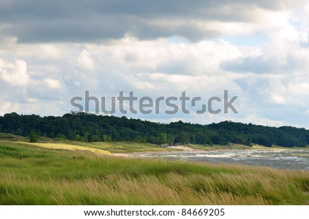 Scenic shoreline of Lake Michigan near Saugatuck with a popular beach in the distance