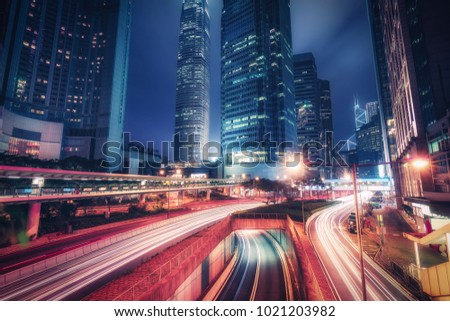 Scenic skyline of downtown Hong Kong with skyscrapers and highways at night. Colourful travel background. #1021203982