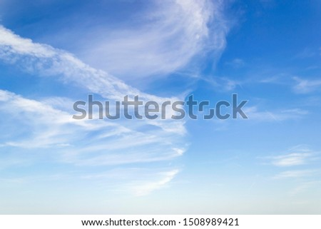 Scenic skyscape with fluffy cirrus and stratus clouds in the stratosphere. Light spindrift clouds high in the blue sky. Different cloud types and atmospheric phenomena. On a sunny day. #1508989421