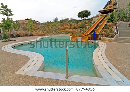Scenic slide into pool in hotel resort
