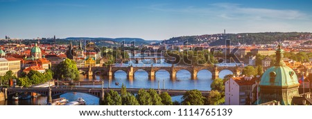Scenic spring sunset aerial view of the Old Town pier architecture and Charles Bridge over Vltava river in Prague, Czech Republic #1114765139